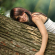 Girl hugging tree — 图库照片