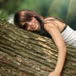 Girl hugging tree — Stock fotografie