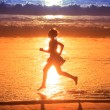 Girl running along ocean — Stock Photo