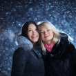 People enjoying winter snow — Stockfoto