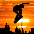 Stock Photo: Jumping skateboarder