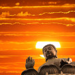 Buddha at sunset — Stock Photo