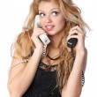 Woman talking on two phones — Stock Photo