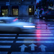 Stock Photo: Car crossing crosswalk at night, blurred motion.