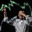 Stock Photo: Scared trader pointing to stock market charts