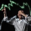 Scared trader pointing to stock market charts — Stock Photo