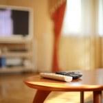 TV remotes in stylish interior — Stock Photo