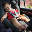 Child sleeping in car — Stock Photo