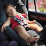 Child sleeping in car — Stock Photo #32426197