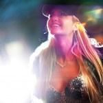 Beautiful blond woman in fur coat in night city — Stock Photo #32426359