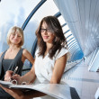 Businesswomen in futuristic interior — Stock Photo
