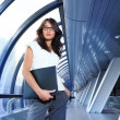 Businesswoman in futuristic interior — Stock Photo