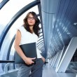 Stock Photo: Businesswoman in futuristic interior