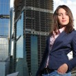Woman in front of modern office buildings — Stock Photo