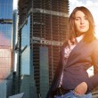Businesswoman in front of construction — Stock Photo