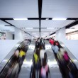 People using escalator — Stockfoto