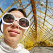Wide angle portrait of young womin sunglasses — Stock Photo #32427065