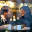 Happy young couple in cafe, having a great time together — Стоковая фотография