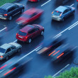 Moving cars, blurred motion — Stock Photo #32427287