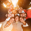 Group of happy young people in circle — Stock Photo