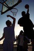 Basketball player silhouette at sunset — Stock Photo