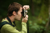 Photographer shooting with compact camera — Stock Photo