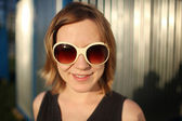 Happy girl in sunglasses — Stock Photo