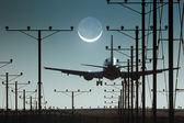 Plane landing in airport at night — Stock Photo