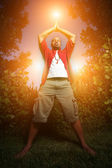 African American man practicing yoga outdoors — Stock Photo