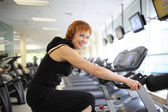 Woman exercising on bike — Stock Photo
