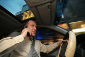 Businessman driving in car — Stock Photo