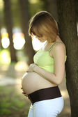 Pregnant woman in park — Stock Photo