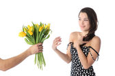 Girl receiving flowers — Stock Photo