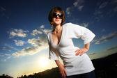 Beautiful woman outdoors at sunset — Stock Photo