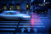 Car crossing crosswalk at night, blurred motion. — Stock Photo