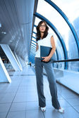 Bautiful young businesswoman in futuristic interior — Stok fotoğraf
