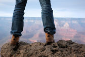 Male feet standing on edge of a cliff — Stok fotoğraf