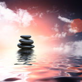 Zen stones reflecting in water background — Stock Photo