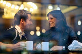 Happy young couple in cafe, having a great time together — Stock Photo
