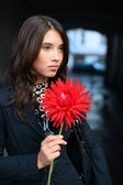 Woman with red flower — Stockfoto