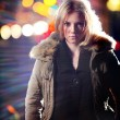 Young blond woman in parka at night. — Stock Photo