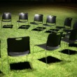 Stock Photo: Black chairs on green grass