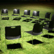 Black chairs on green grass — Stock Photo