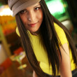 Foto Stock: Hip beautiful young woman in cap hat