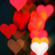 Stock Photo: Background with heart-shaped highlights.