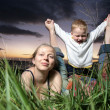 Young family with small child outdoors — Stock Photo