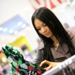 Beautiful young woman shopping in a store — Stock Photo