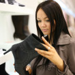 Stok fotoğraf: Woman shopping at fashion shoe store