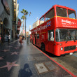 Double-decker tour bus at Hollywood Blvd — Stock Photo