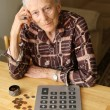 Senior woman counting coins — Stock Photo